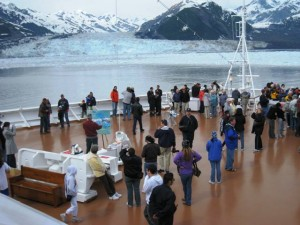 Guests on deck aboard HAL\'s Oosterdam as she sails Alaska\'s Hubbard Glacier